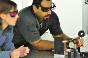 Mohammad and Kelsie adjust optics